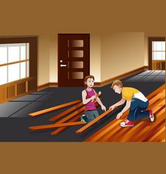 Young couple installing hardwood floor vector