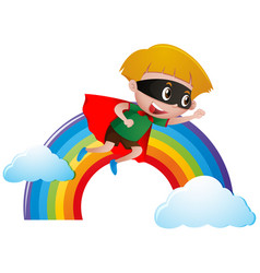 boy dressed as hero flying over the rainbow vector image