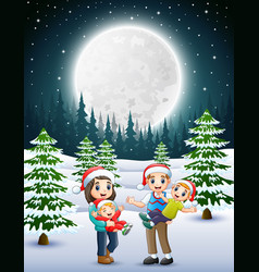 happy familly in the snowy garden at night vector image