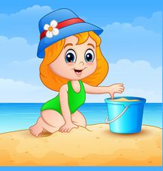 Little girl cartoon playing a sand on beach vector