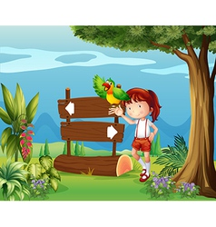 A parrot and a girl beside a signboard in the vector image