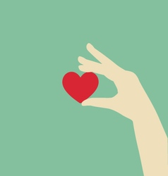 Flat Hand Holding Red Heart vector image vector image