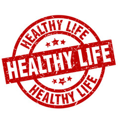 Healthy life round red grunge stamp vector