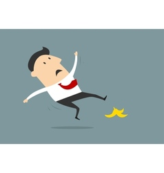 Businessman slipping on banana peel in flat style vector image