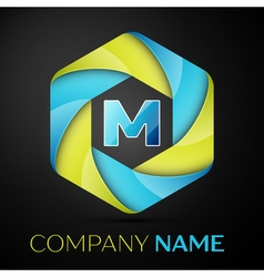 M Letter colorful logo in the hexagonal on black vector image