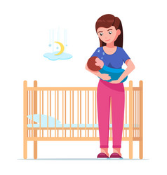woman holding a sleeping baby next to a baby crib vector image