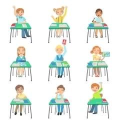 Children Sitting At School Desks In Class vector