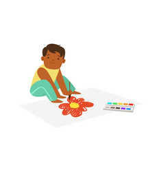 cute litttle boy sitting onthe floor and drawing vector image vector image