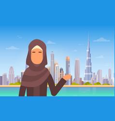 arab woman showing dubai skyline panorama modern vector image