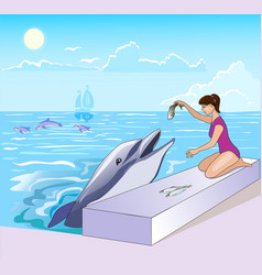 a cartoon girl feeding a dolphin with fish the vector image