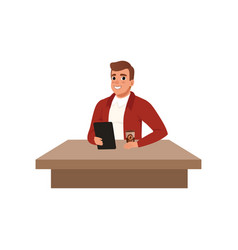smiling young man sitting at the desk with book vector image