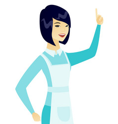 young asian cleaner pointing her forefinger up vector image vector image