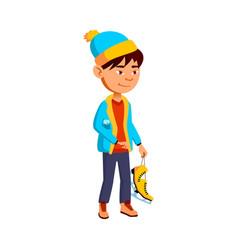 Preteen boy in winter seasonal clothes holding vector