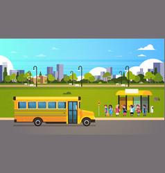 Group pupils children waiting yellow school bus vector