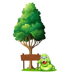 A monster and a signboard under the tree vector image