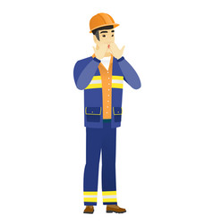 Shoked asian builder covering his mouth vector