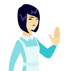 young asian cleaner showing palm hand vector image