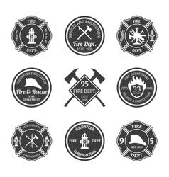 Fire department emblems black vector image