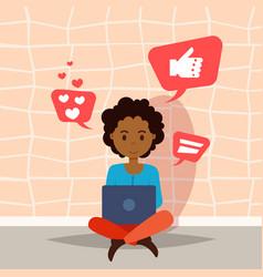 African woman using laptop thinking social media vector
