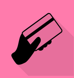 hand holding a credit card black icon with flat vector image