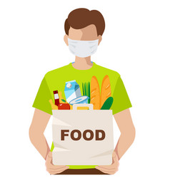 Volunteer in a medical mask with a food package vector