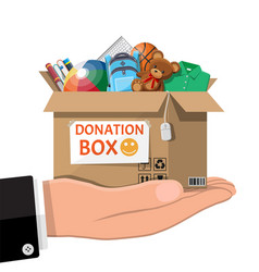 donation box full toys books clothes devices vector image