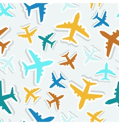 Seamless pattern with colorful airplanes vector