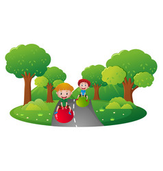 two boys playing on big ball on the road vector image