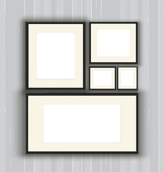 Blank picture frames on a wooden wall background vector image vector image