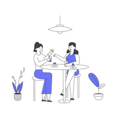 Couple girl friends sitting at table with food vector