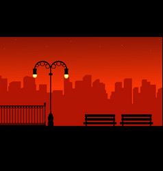 silhouette of urban and street lamp on red vector image