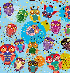 Seamless pattern with colorful owls on a blue vector image