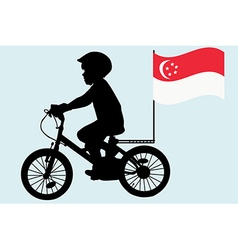 A kid rides a bicycle with Singapore flag vector image
