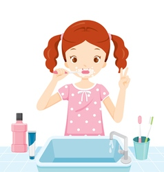 Girl In Pyjamas Brushing Her Teeth In Bathroom vector