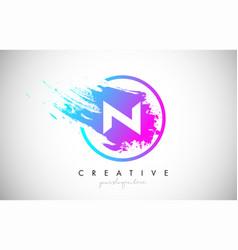 N artistic brush letter logo design in purple vector