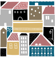Seamless pattern with old town buildings vector