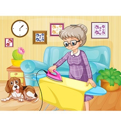 Old woman ironing clothes in a room vector image vector image
