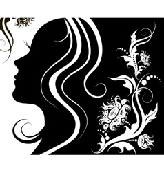 facial profile of a young woman with a flower vector image