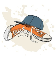 Drawing with sneakers and baseball cap vector image