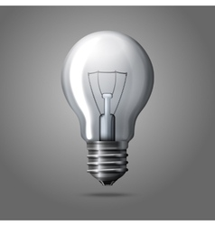 Realistic light bulb isolated on grey background vector image
