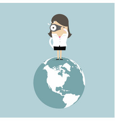 Businesswoman on world and look at binoculars vector