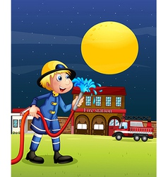 A fireman holding a hose vector image vector image
