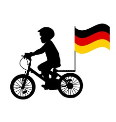 A kid rides a bicycle with German flag vector image