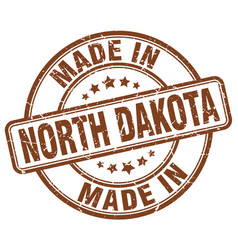 made in north dakota brown grunge round stamp vector image