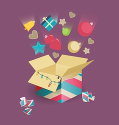 Christmas decorations falling into a box vector image