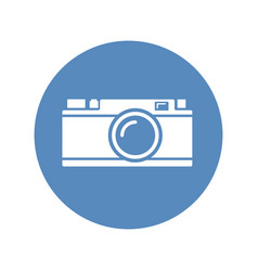 white rangefinder camera icon placed on blue vector image