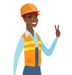 Young african builder showing victory gesture vector