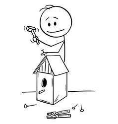 cartoon man building birdhouse vector image