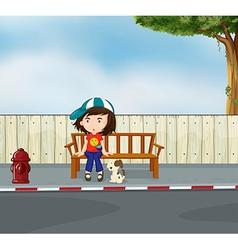 A girl and dog sitting along the road vector