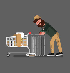 Homeless with a cart digs in the garbage vector